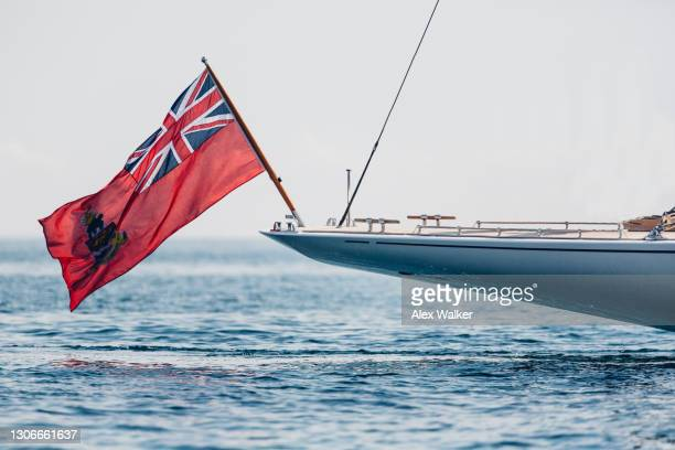 stern (rear) of a large white sailing yacht in calm ocean - insignia stock pictures, royalty-free photos & images