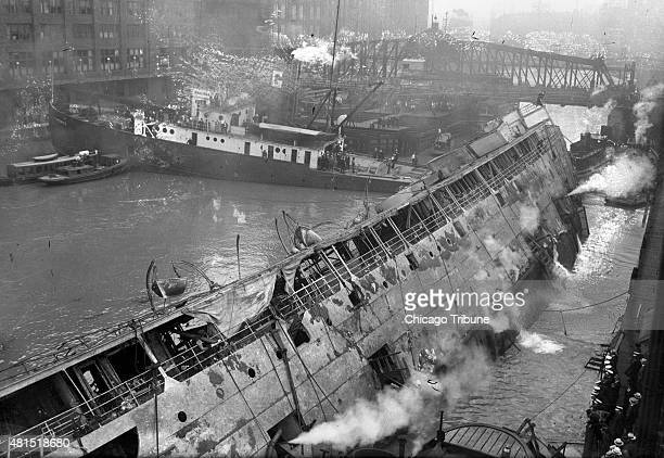 "Stern side view of the SS Eastland shows the decks raised out of the water Aug. 13, 1915 in Chicago. ""The overturned excursion steamer Eastland..."