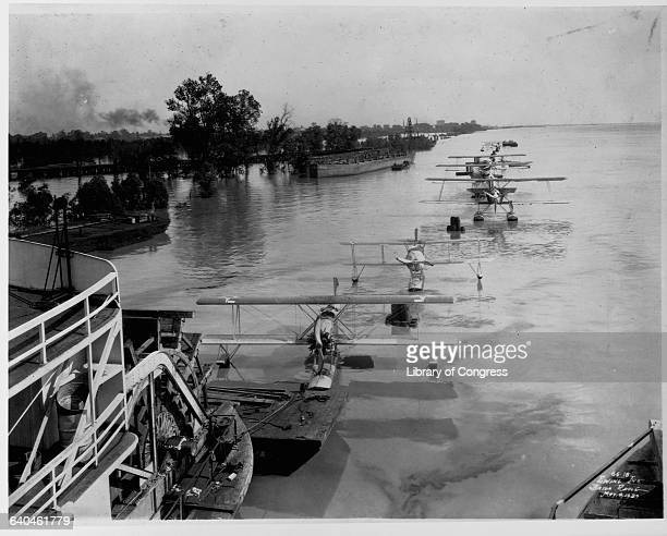 A sternwheeler tows a string of seaplanes down the Mississippi River during a flood 1927