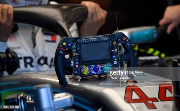 A sterring wheel is seen on the car of Mercedes' British driver Lewis Hamilton after the first Formula One practice session in Melbourne on March 23...