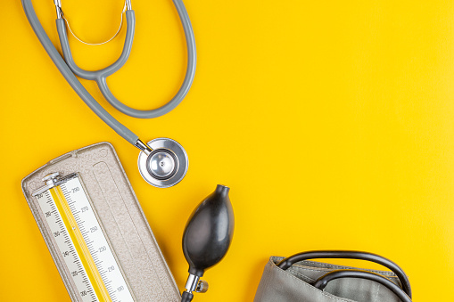 stethoscope and blood pressure 1009984764