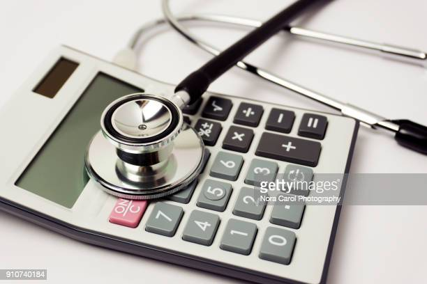 Stethoscope and Calculator on White Background