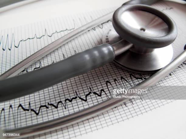 stethoscope and electrocardiogram printout - heart disease stock pictures, royalty-free photos & images
