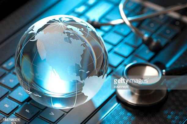 Stethoscope and globe on a laptop