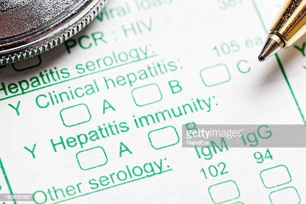 stethoscope and pen on blood test form for hepatitis - liver stock photos and pictures