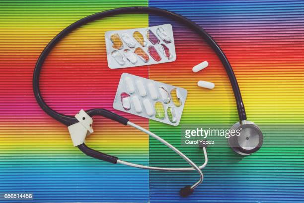 stethoscope and pills,colorful background