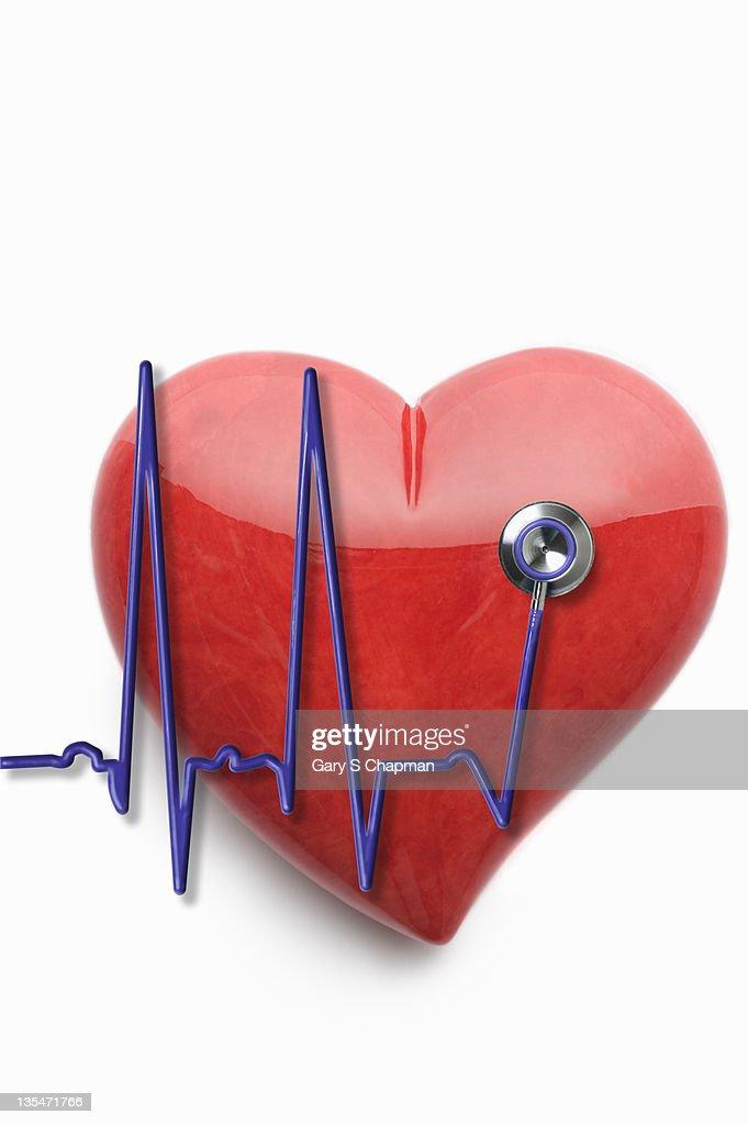 EKG stethoscope and stone heart : Stock Photo