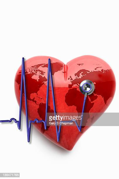 EKG stethoscope and stone heart with world map