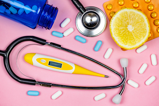 Stethoscope, Capsules and pills and Digital medical thermometer. Medical concept - gettyimageskorea