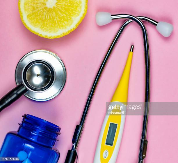 stethoscope, capsules and pills and digital medical thermometer. medical concept - digital thermometer ストックフォトと画像
