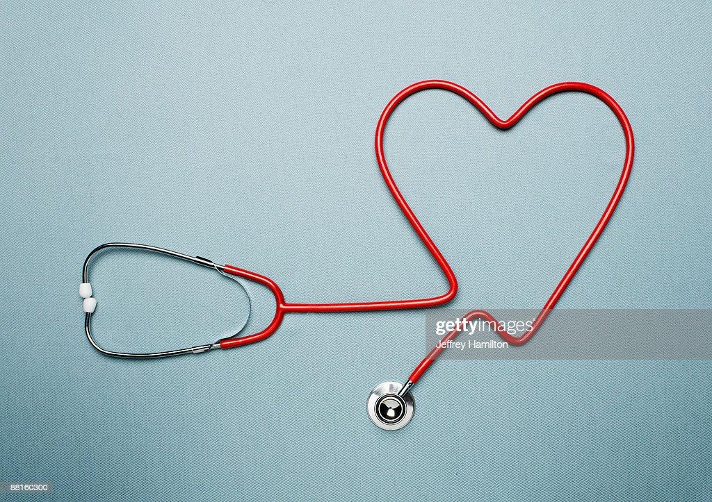 Stethoscope forming heart shape : Stock Photo