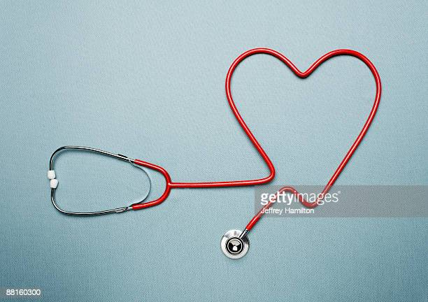 stethoscope forming heart shape - heart health stock pictures, royalty-free photos & images