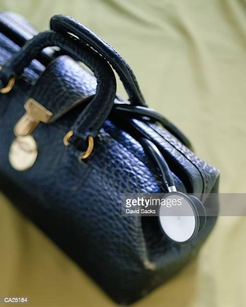 stethoscope hanging out of doctor's bag, close-up - dokterstas stockfoto's en -beelden