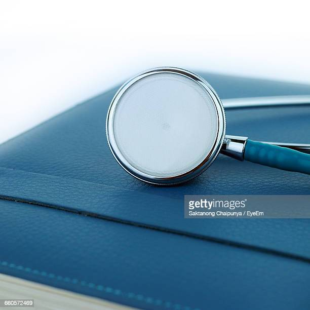 Stethoscope On Book At Clinic