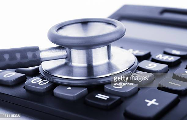 Stethoscope on calculator representing healthcare costs