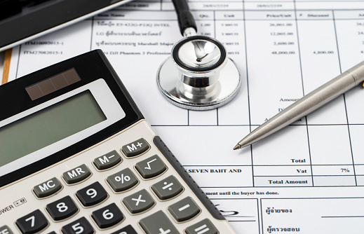 Stethoscope on medical billing statement on table, all text is anonymous - gettyimageskorea