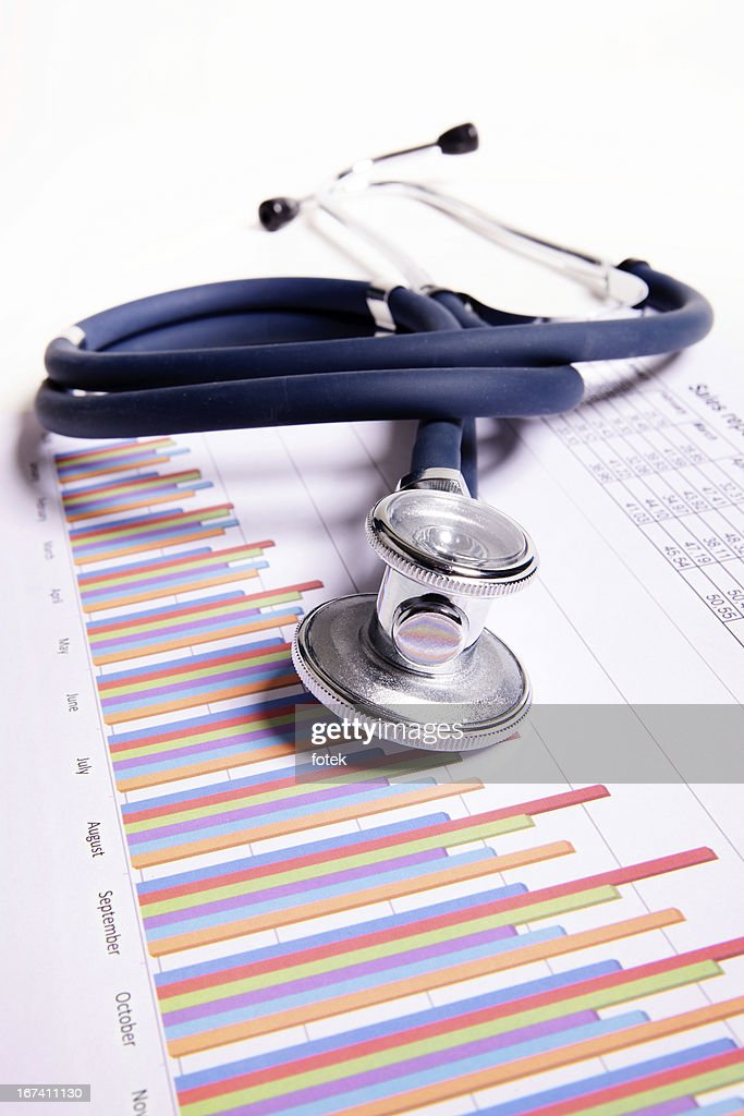 A stethoscope on top of bar charts : Stock Photo