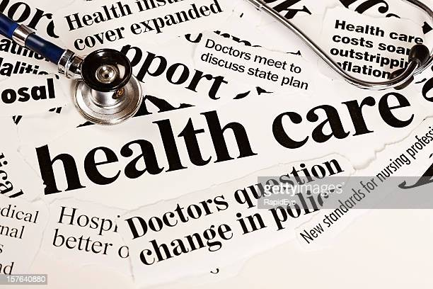 Stethoscope rests on headlines covering health care