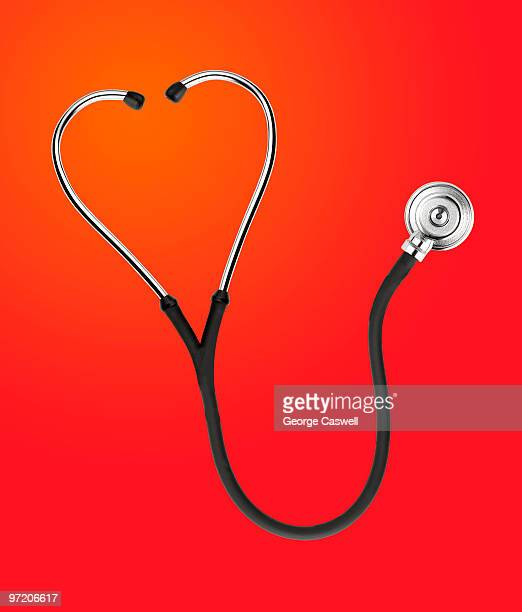 Stethoscope shaped like heart on red