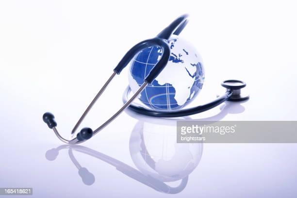 Stethoscope surrounding a blue globe