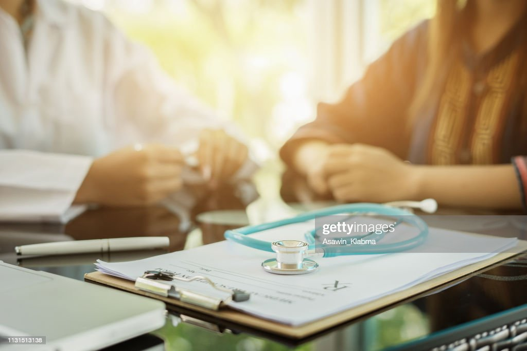 Stethoscope with clipboard and Laptop on desk,Doctor working in hospital writing a prescription, Healthcare and medical concept,test results in background,vintage color,selective focus : Stock Photo