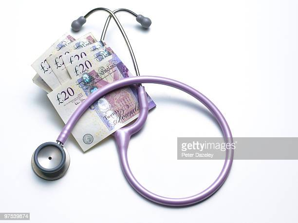 Stethoscope with GBP £20 notes