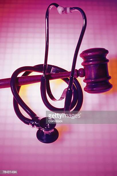 stethoscope wrapped around gavel - lawsuit stock pictures, royalty-free photos & images