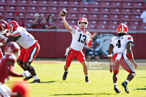 Stetson Bennett of the Georgia Bulldogs throws a pass in the first half of a game against the Arkansas Razorbacks at Razorback Stadium on September...