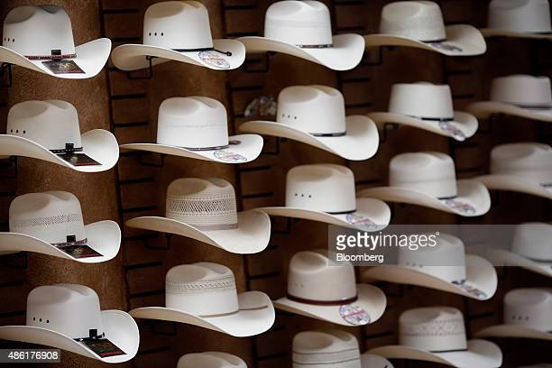 Stetson brand cowboy hats are displayed on a wall inside the showroom of the Hatco Inc manufacturing facility in Garland Texas US on Friday Aug 28...