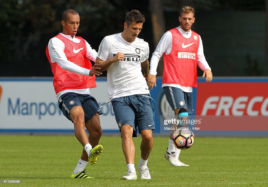 Stevan Jovetic (R) is challenged by Joao Miranda (L) during the FC Internazionale training session at the club's training ground 'La Pinetina' on September 30, 2016 in Como, Italy.