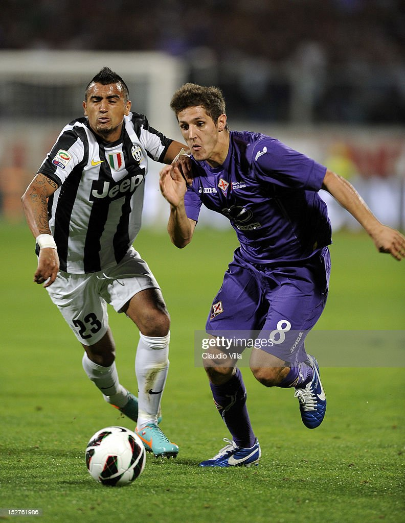 Stevan Jovetic of ACF Fiorentina and Arturo Vidal (L) of FC Juventus compete for the ball during the Serie A match between ACF Fiorentina and FC Juventus at Stadio Artemio Franchi on September 25, 2012 in Florence, Italy.