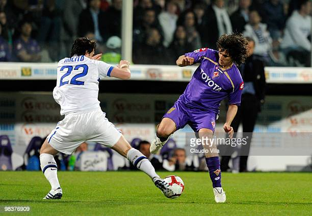 Stevan Jovetic of ACF Fiorentina competes for the ball with Diego Milito of FC Internazionale Milano during the Serie A match between ACF Fiorentina...
