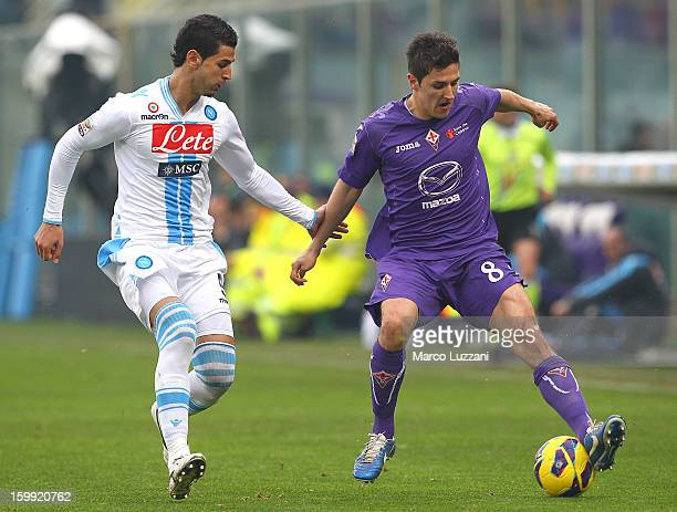 Stevan Jovetic of ACF Fiorentina competes for the ball with Miguel Angel Britos of SSC Napoli during the Serie A match between ACF Fiorentina and SSC...