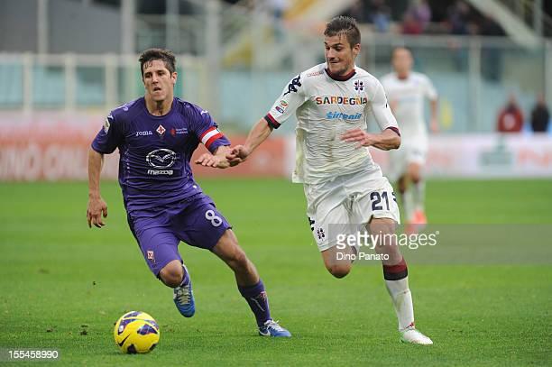 Stevan Jovetic of ACF Fiorentina competes with Daniele Dessena of Cagliari Calcio during the Serie A match between ACF Fiorentina and Cagliari Calcio...