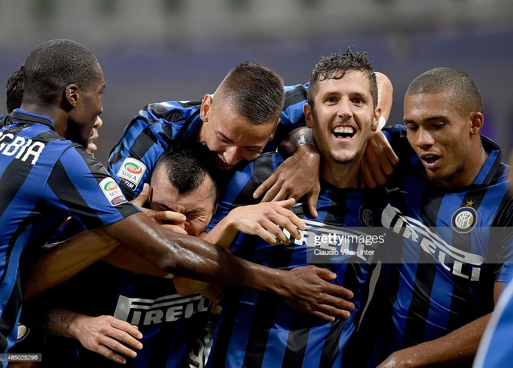 Stevan Jovetic of FC Internazionale (C) celebrates after scores the opening goal during the Serie A match between FC Internazionale Milano and Atalanta BC at Stadio Giuseppe Meazza on August 23, 2015 in Milan, Italy.