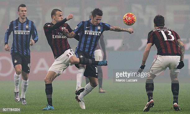 Stevan Jovetic of FC Internazionale Milano competes for the ball with Luca Antonelli of AC Milan during the Serie A match between AC Milan and FC...