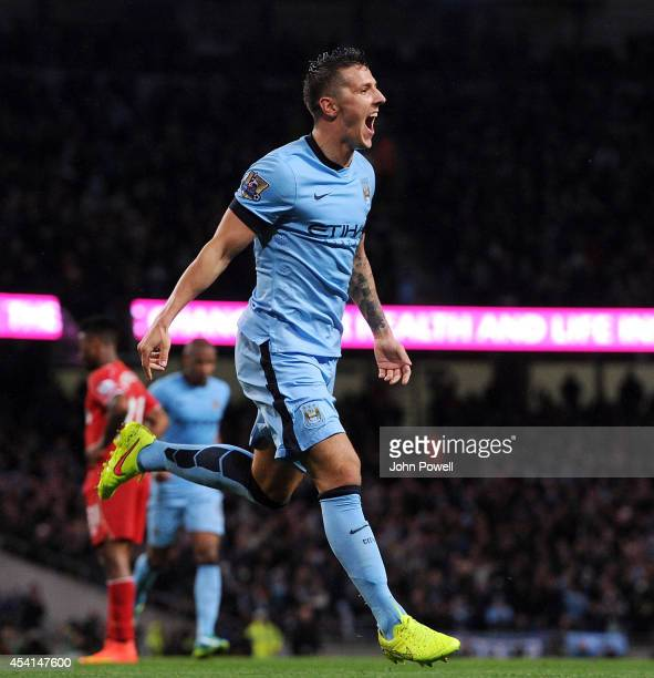 Stevan Jovetic of Manchester City celebrates after scoring the opening goal during the Barclays Premier Leauge match between Manchester City and...