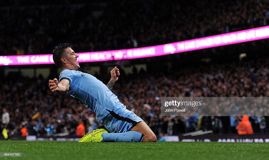 Stevan Jovetic of Manchester City celebrates after scoring the opening goal during the Barclays Premier Leauge match between Manchester City and Liverpool at Etihad Stadium on August 25, 2014 in Manchester, England.