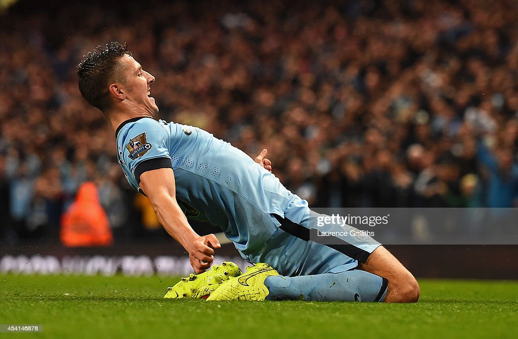 Stevan Jovetic of Manchester City celebrates scoring the opening goal during the Barclays Premier League match between Manchester City and Liverpool at the Etihad Stadium on August 25, 2014 in Manchester, England.