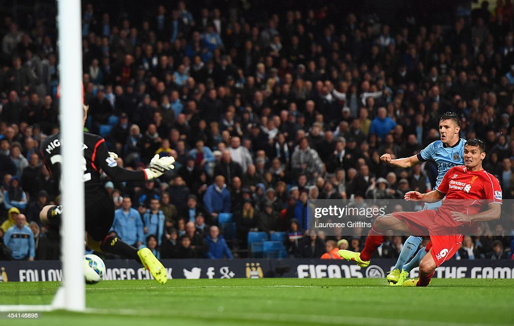 Stevan Jovetic of Manchester City scores the opening goal during the Barclays Premier League match between Manchester City and Liverpool at the Etihad Stadium on August 25, 2014 in Manchester, England.