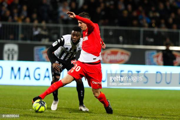 Stevan Jovetic of Monaco and Ismael Traore of Angers during the Ligue 1 match between Angers SCO and AS Monaco at Stade Raymond Kopa on February 10...