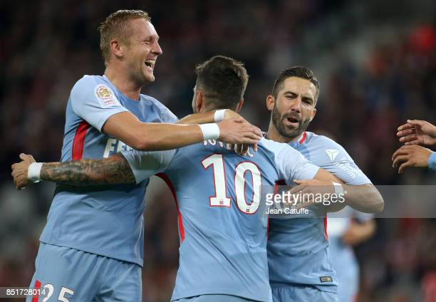 Stevan Jovetic of Monaco celebrates his goal between Kamil Glik and Joao Moutinho during the French Ligue 1 match between Lille OSC and AS Monaco at...