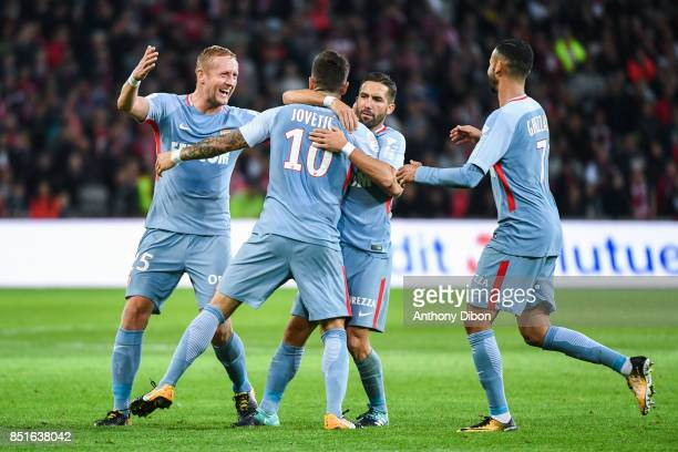 Stevan Jovetic of Monaco celebrates his goal with Joao Moutinho and Kamil Glik during the Ligue 1 match between Lille OSC and AS Monaco at Stade...