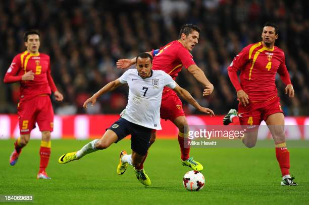 Stevan Jovetic of Montenegro clashes with Andros Townsend of England during the FIFA 2014 World Cup Qualifying Group H match between England and...