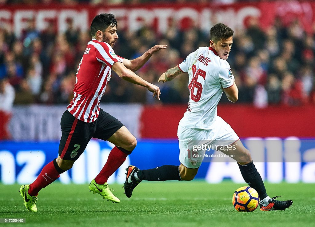 Stevan Jovetic of Sevilla FC (R) being followed by Eneko Boveda of Athletic Club (L) during the La Liga match between Sevilla FC and Athletic Club de Bilbao at Estadio Ramon Sanchez Pizjuan on March 02, 2017 in Seville, Spain.