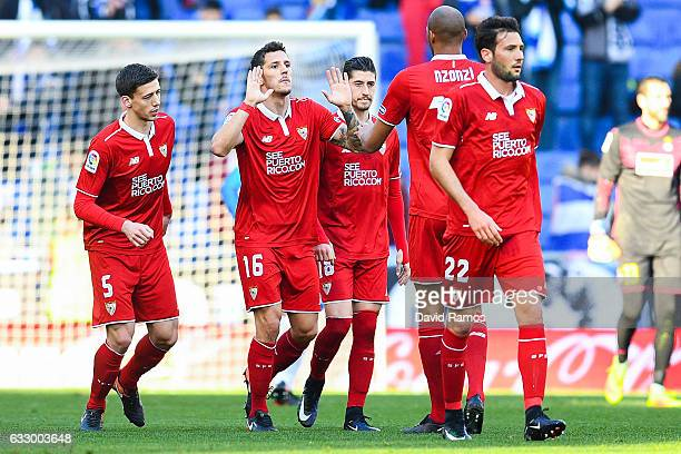 Stevan Jovetic of Sevilla FC celebrates with his team mates after scoring his team's first goal during the La Liga match between RCD Espanyol and...