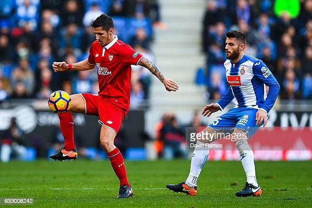 Stevan Jovetic of Sevilla FC competes for the ball with David Lopez of RCD Espanyol during the La Liga match between RCD Espanyol and Sevilla FC at...