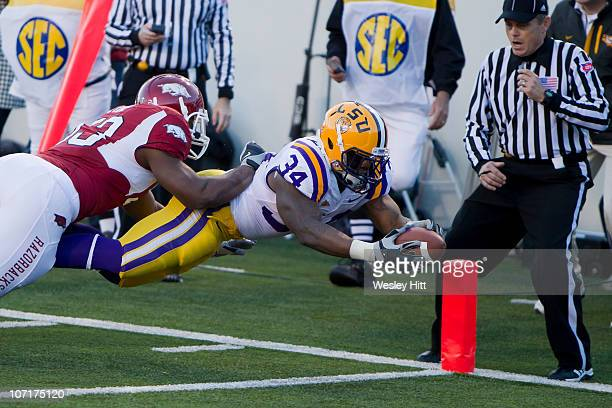 Stevan Ridley of the LSU Tigers dives into the corner of the end zone during a game against Arkansas Razorbacks at War Memorial Stadium on November...