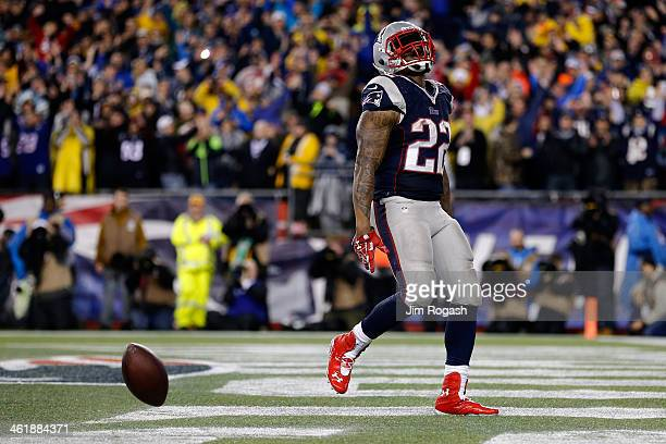 Stevan Ridley of the New England Patriots celebrates with teammates Matthew Slater and James Develin after scoring a touchdown in the fourth quarter...