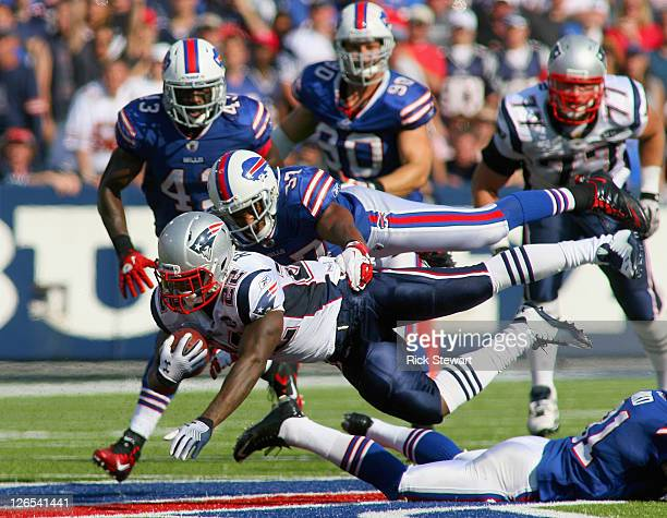 Stevan Ridley of the New England Patriots is tackled by George Wilson of the Buffalo Bills at Ralph Wilson Stadium on September 25, 2011 in Orchard...